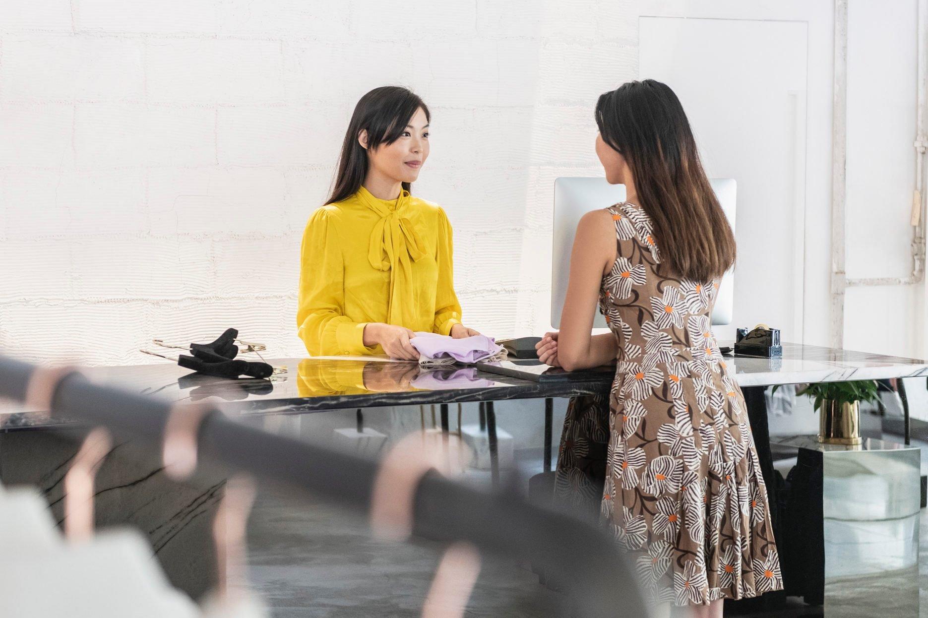 Female customer buying garment in modern boutique