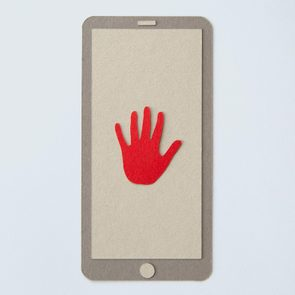 paper smart phone with a red hand
