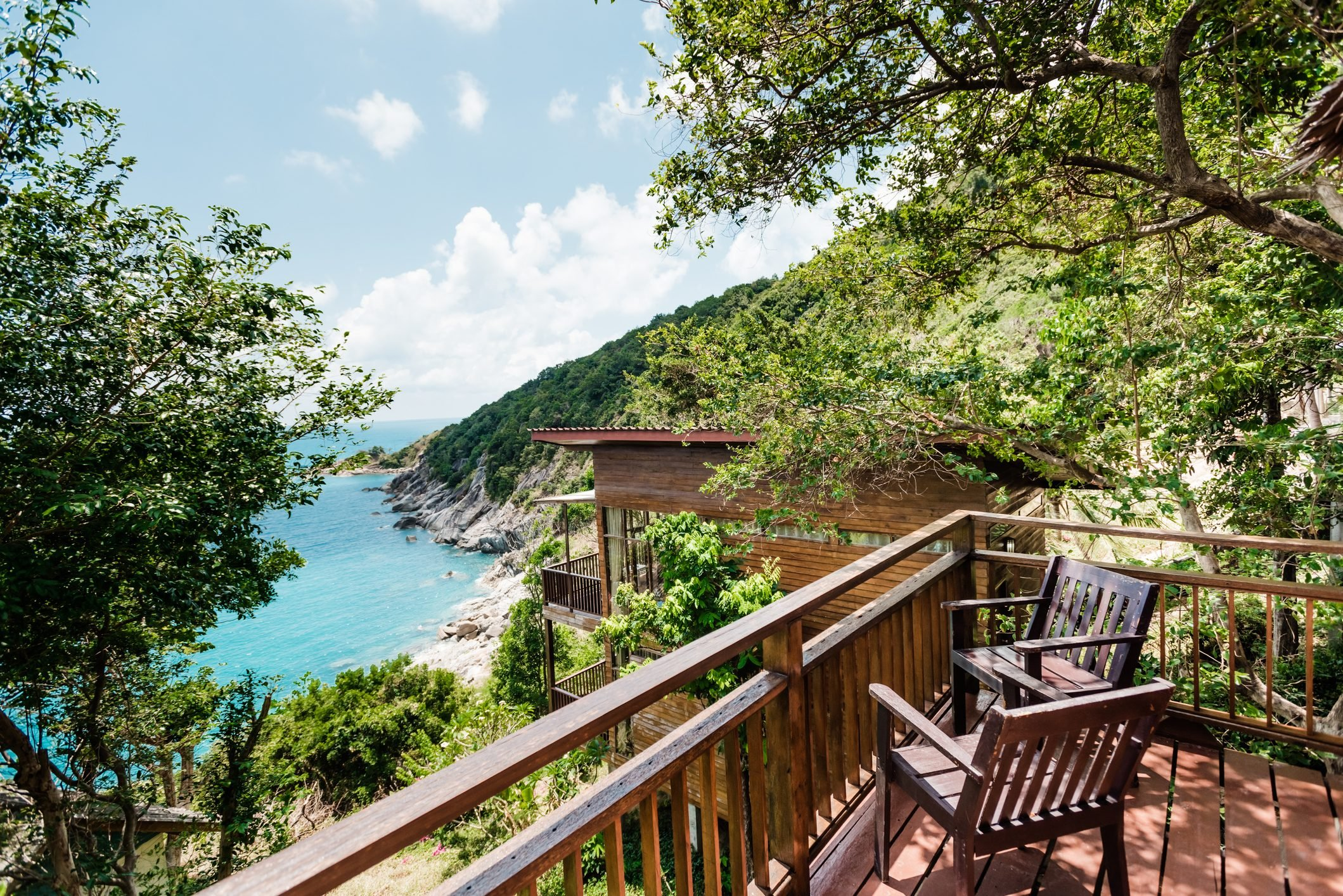 paradise house in the jungle with an ocean view wooden terrace blue sea and mountains