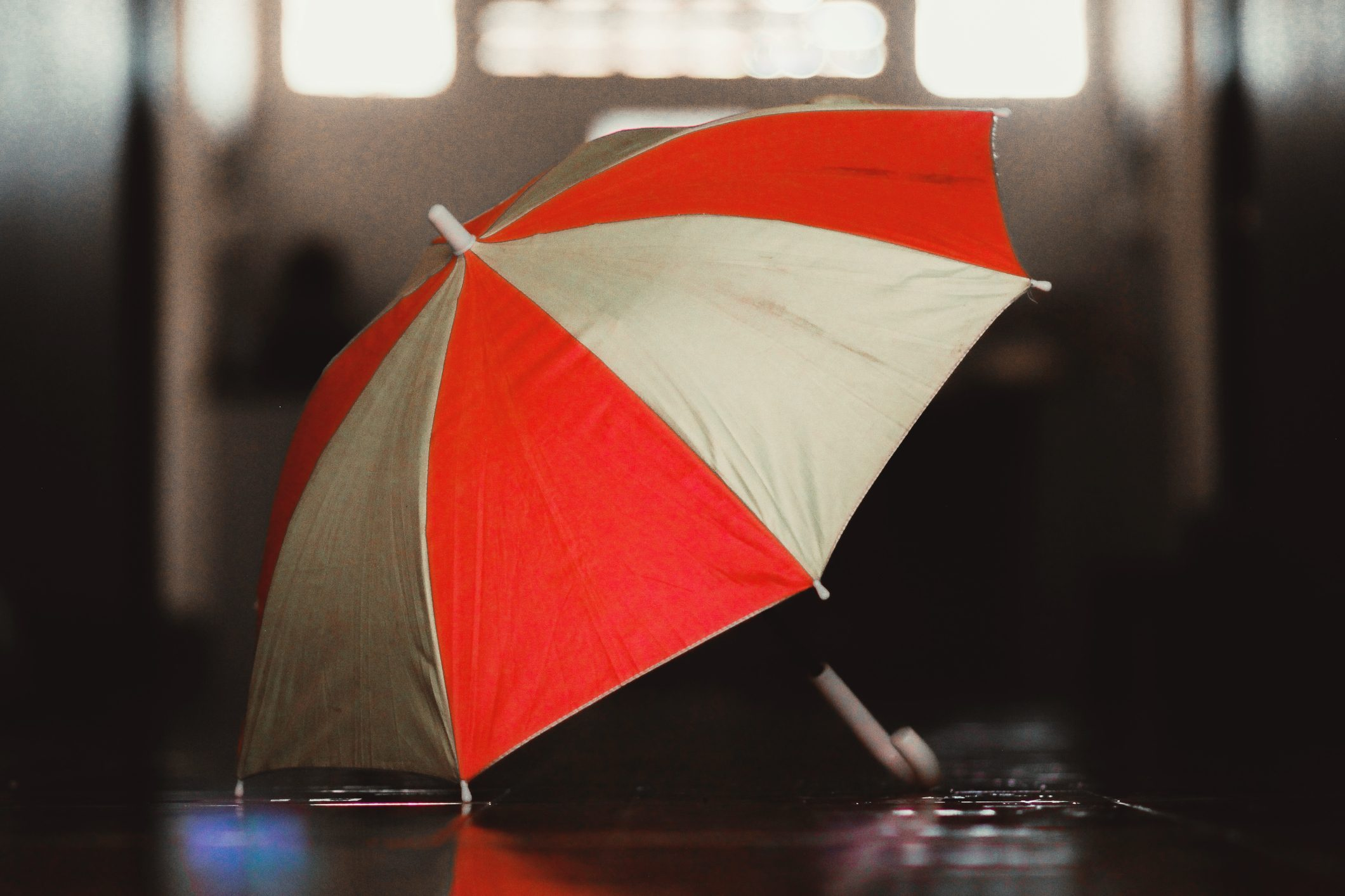 Close-Up Of Red And White Striped Umbrella
