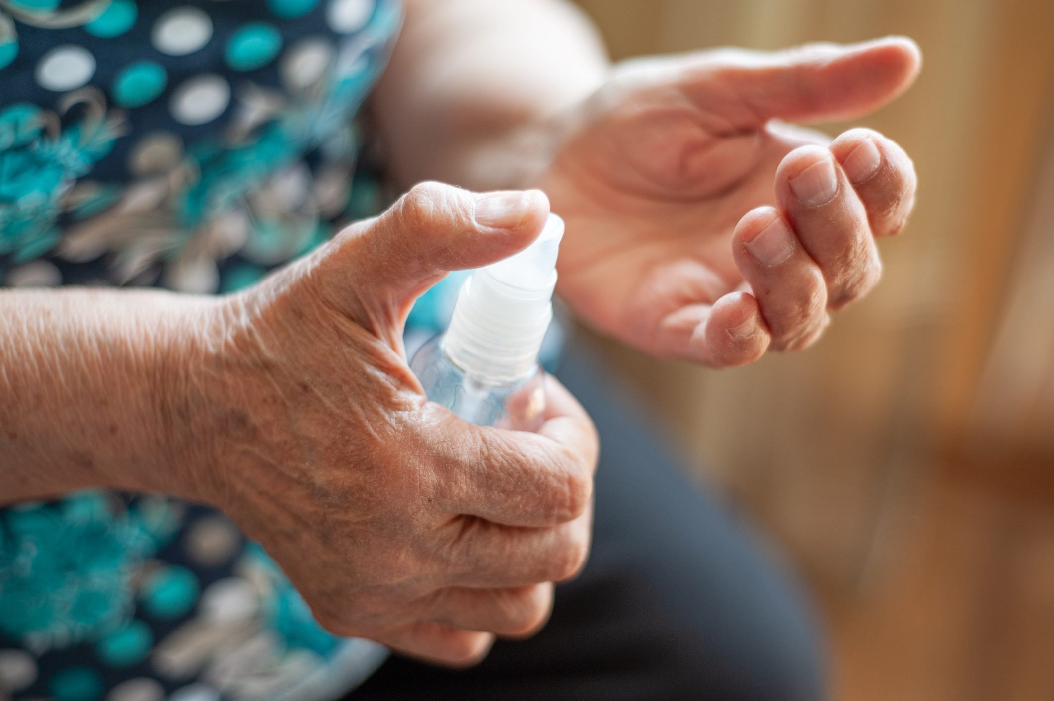 Coronavirus Covid-19 old woman applies a sanitizer on her hands, prevention, quarantine