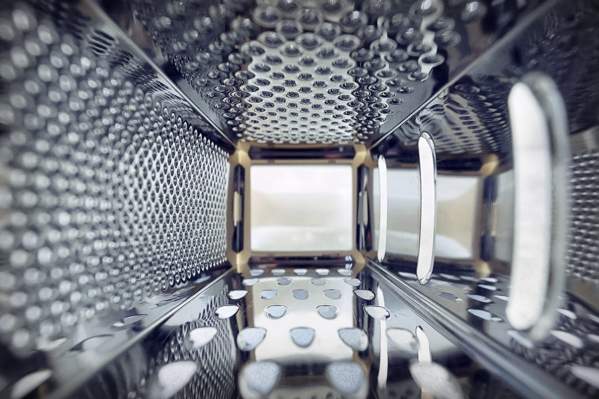 Inner view of a steel grater in the kitchen.