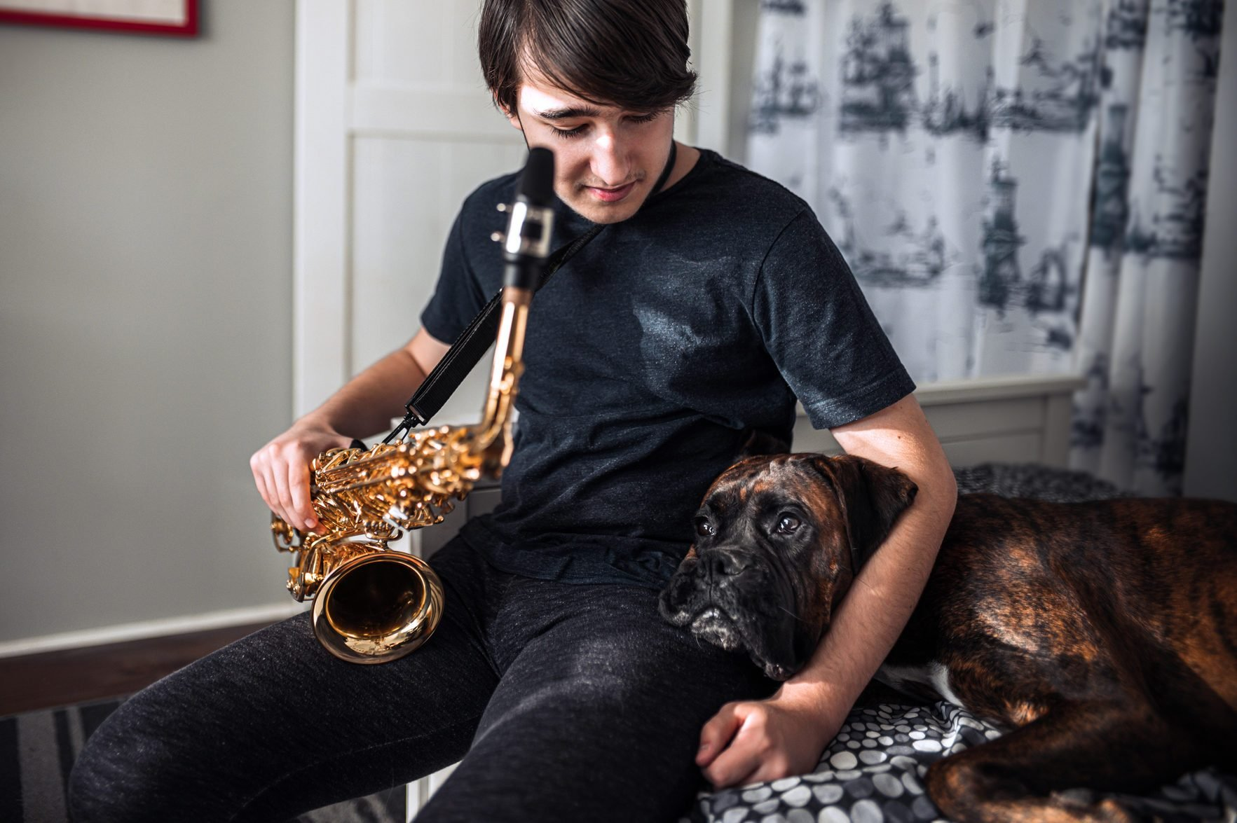 Teenager playing sax in his room