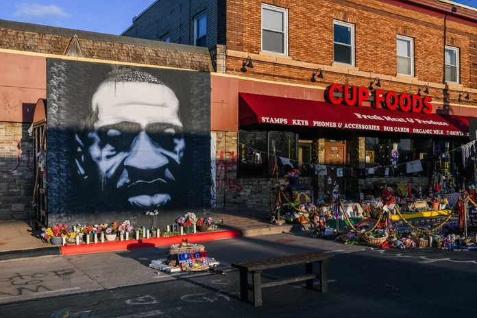 A mural of George Floyd is shown next to Cup Foods on March 31, 2021 in Minneapolis, Minnesota.