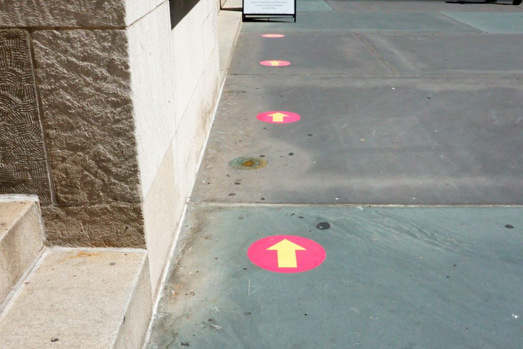 Arrows indicating Social distancing guide on sidewalk, New York City