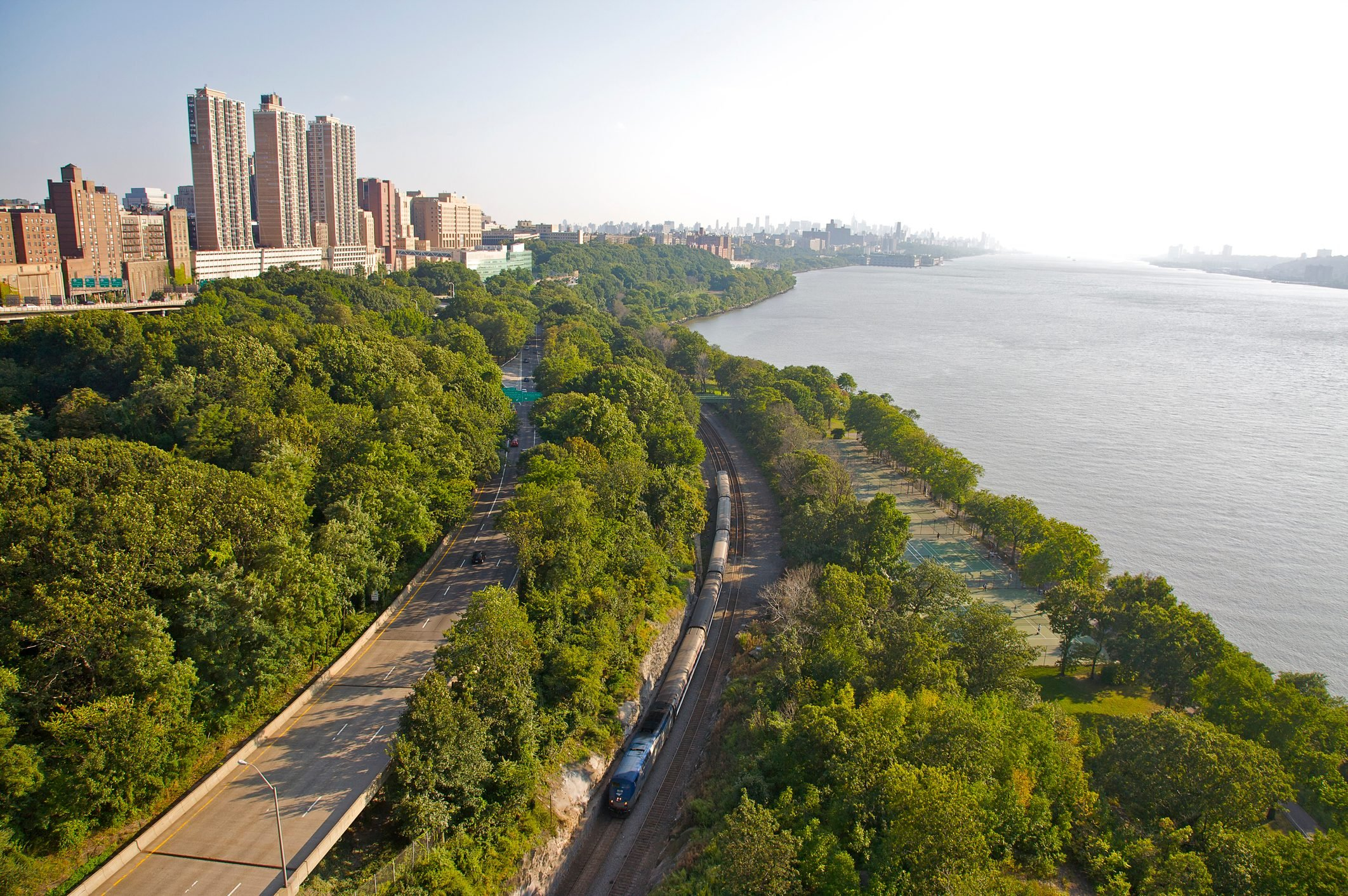 Aerial view of Upper West Side and Riverside Park, with Amtrak train below, from George Washington Bridge, New York, NY, U.S.A.