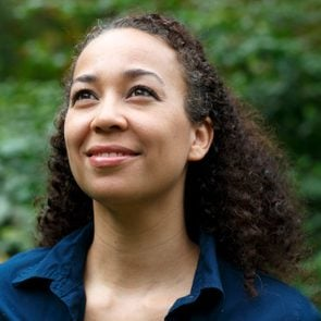 Mixed race woman in nature, smiling