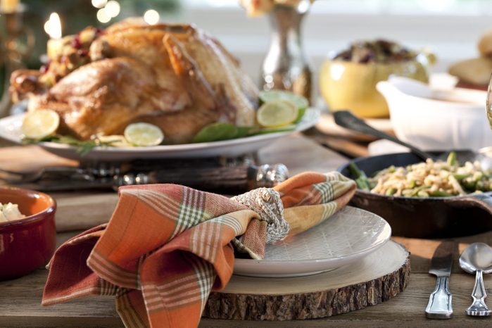 thanksgiving dinner table with sliced wood chargers