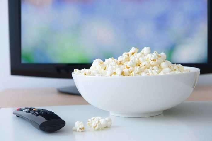 USA, New Jersey, Jersey City, Television set and bowl of popcorn