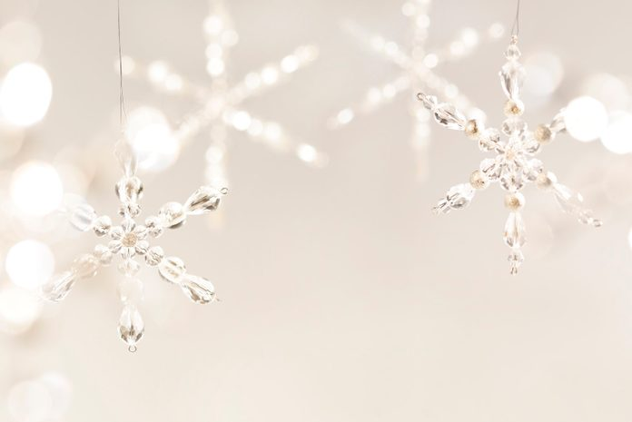 Tan Christmas background with large crystal snowflakes