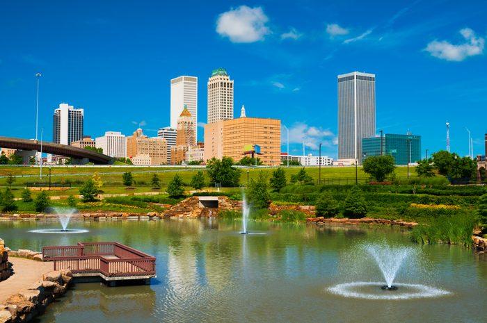 Tulsa skyline, pond, and fountains