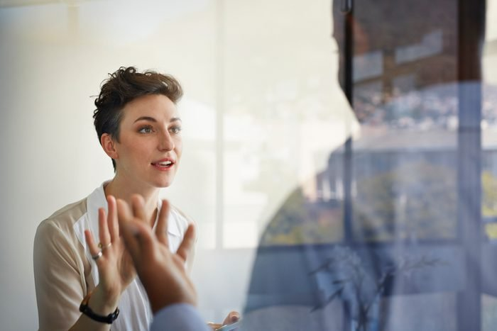Businesswoman having discussion with male coworker