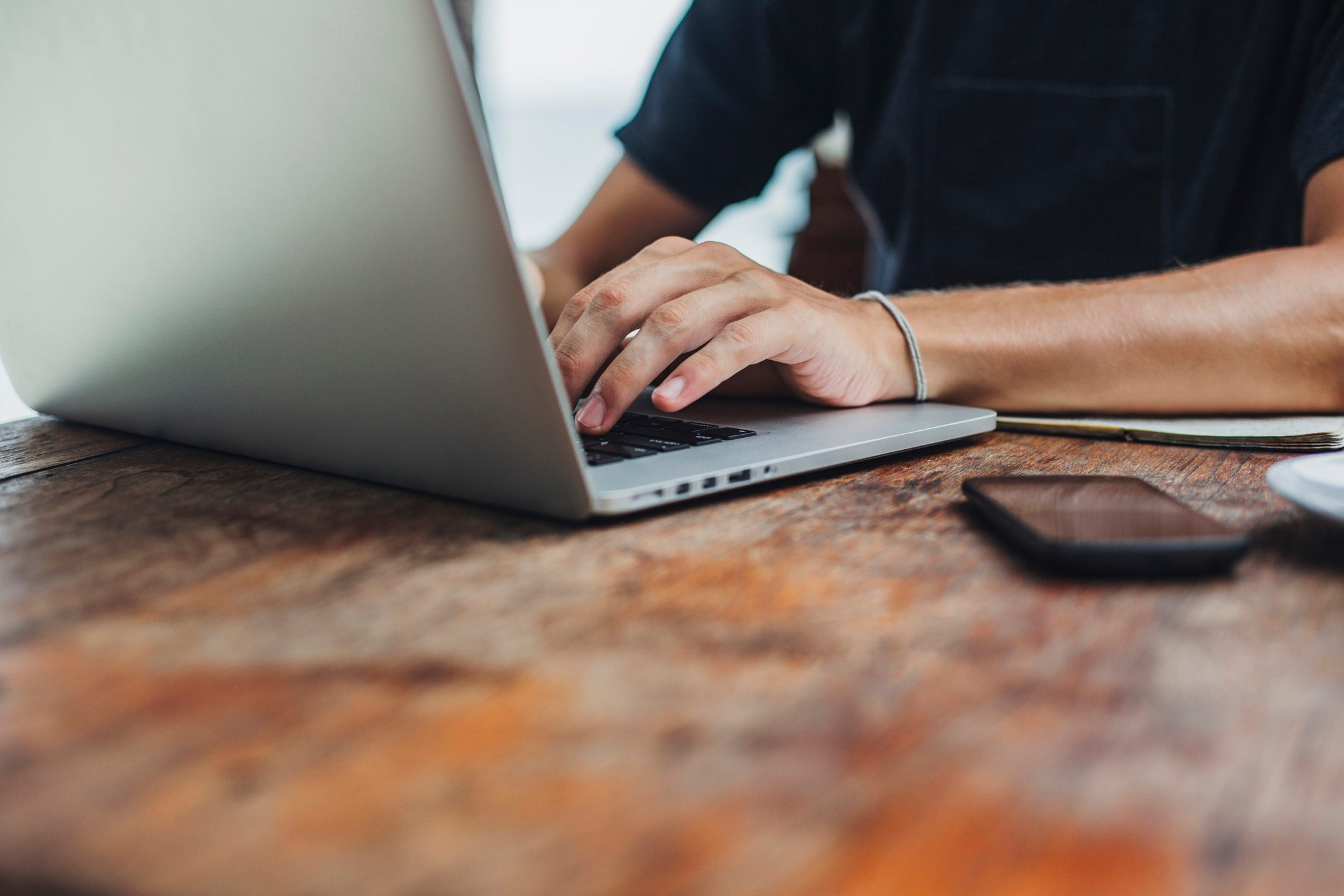 Caucasian man using laptop at table