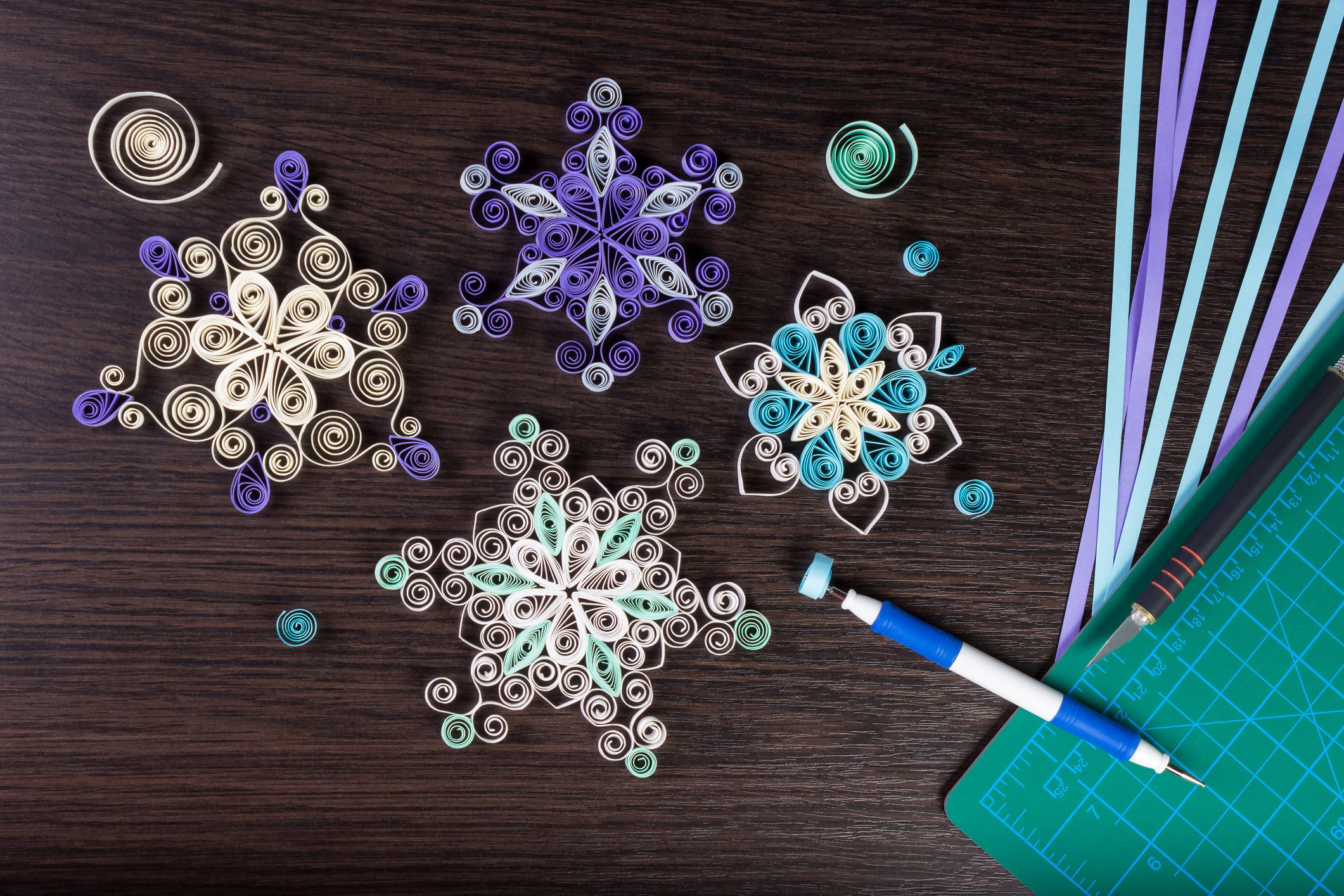 Handmade paper snowflakes with tools for quilling