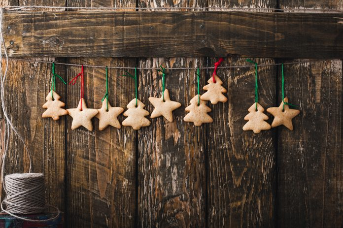Christmas homemade gingerbread cookies on rustic wooden background with copy-space