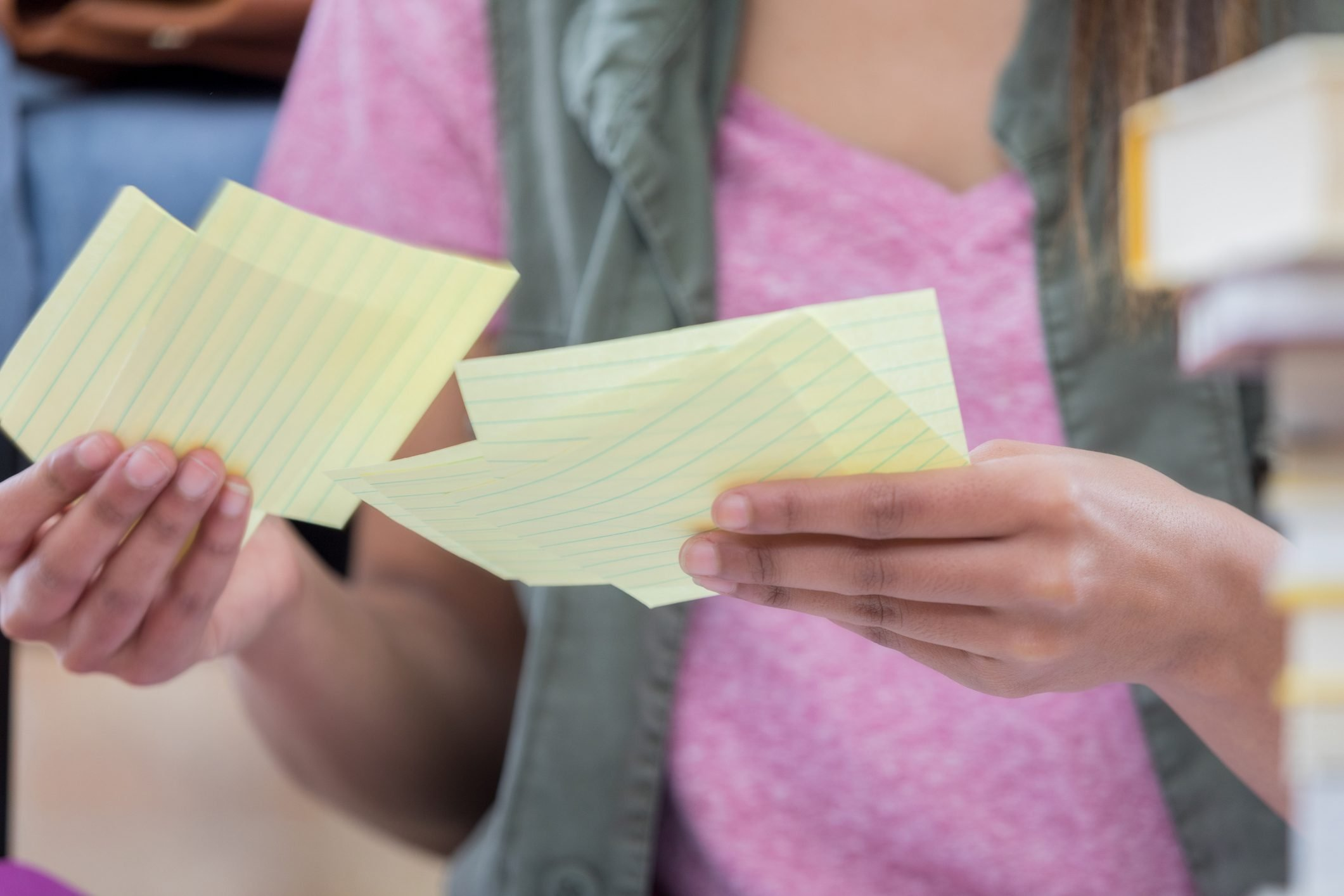 Unrecognizable college student uses notecards