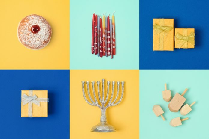 Jewish holiday Hanukkah design with menorah, gift boxes, dreidel. View from above.