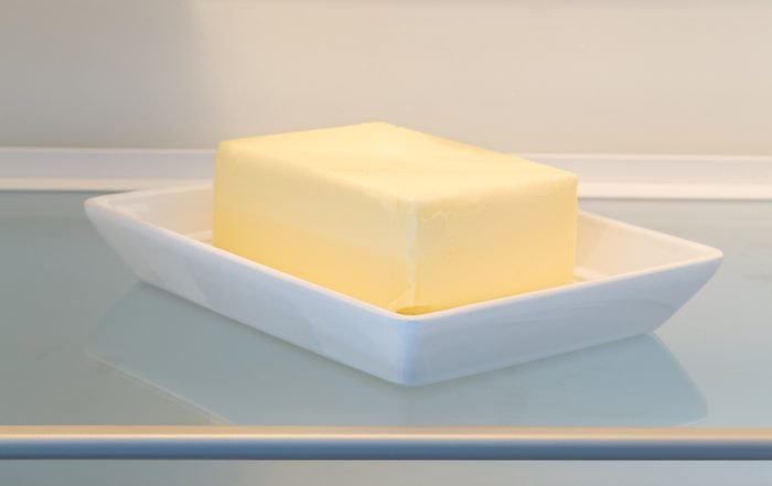 Butter in opened refrigerator concept