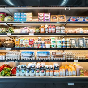 Refrigerator shelves in a grocery delicatessen store