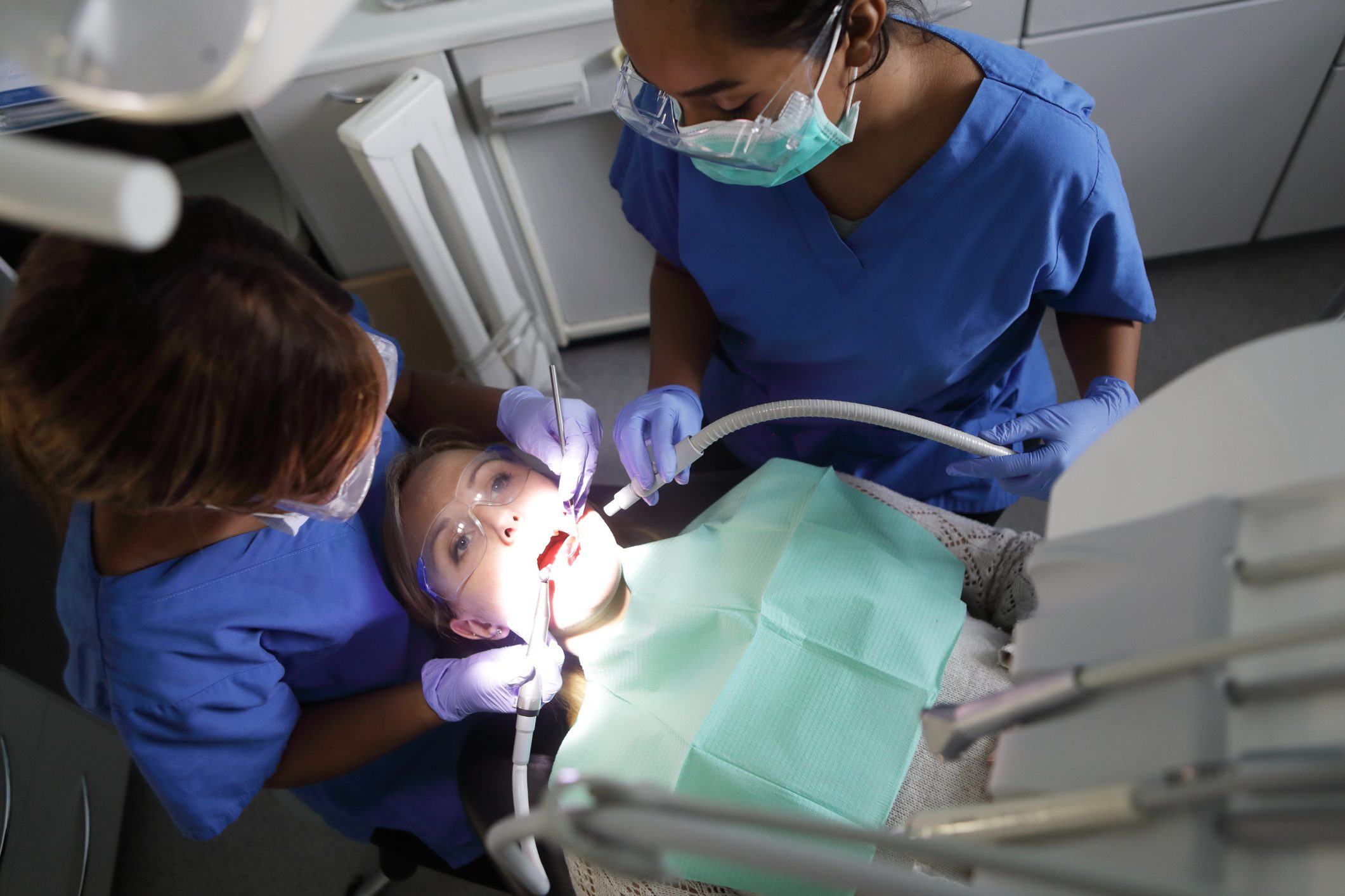 Dentist working on patient in chair