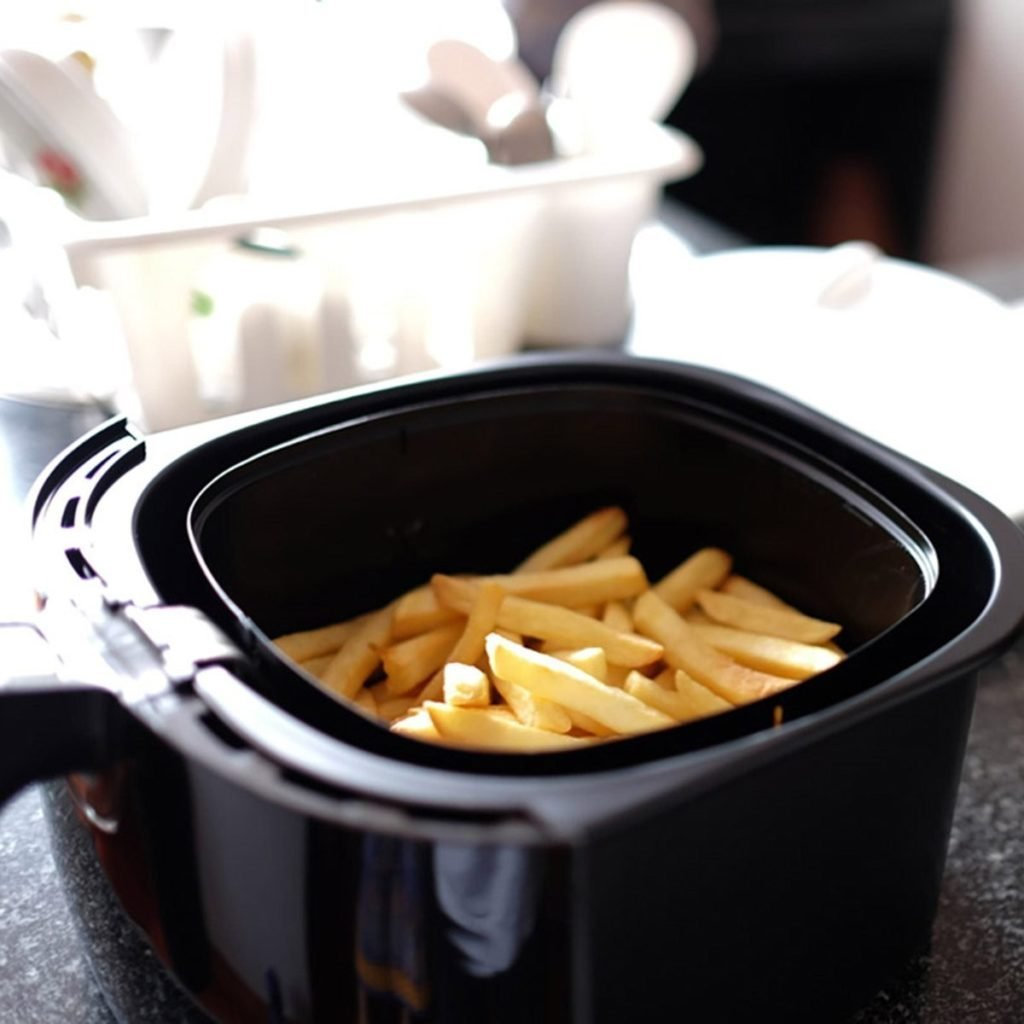Home-made french fries in modern airfryer