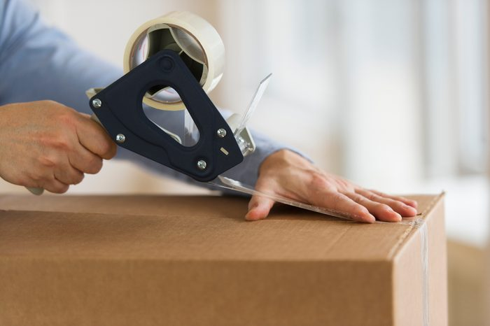 Jersey City, New Jersey, Man's hands packing delivery