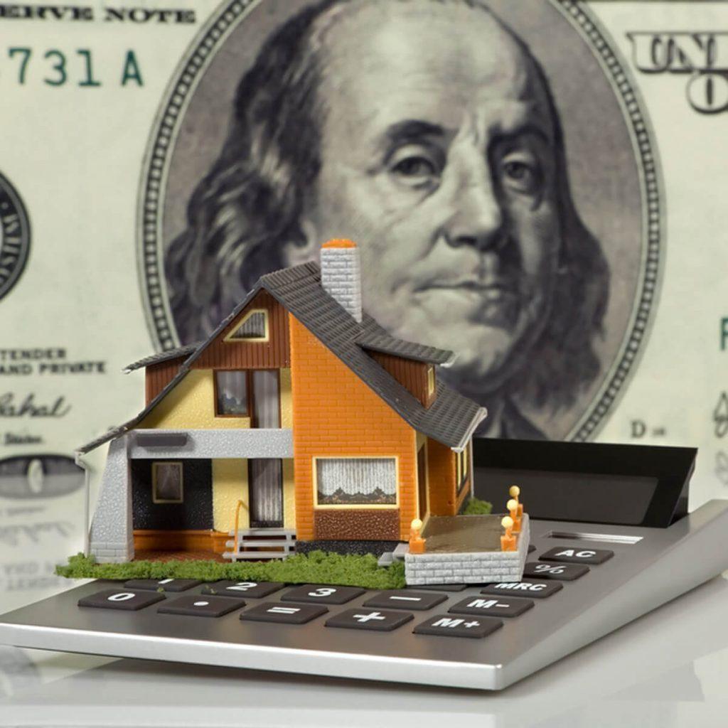 house on a calculator concept