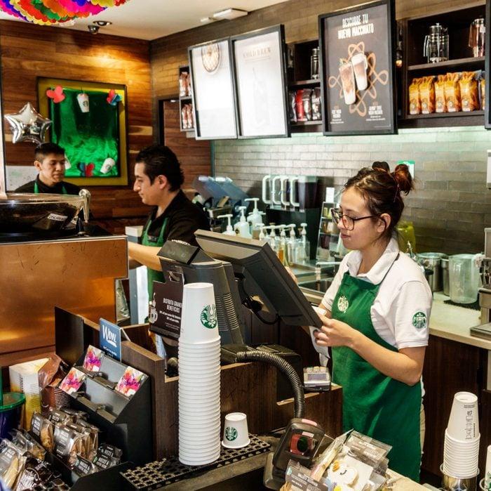 Employee baristas inside Starbucks Coffee