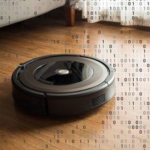 robot vacuum on wood floor with binary computer code overlay