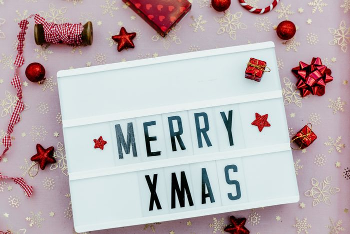merry xmas in a lightbox in red background