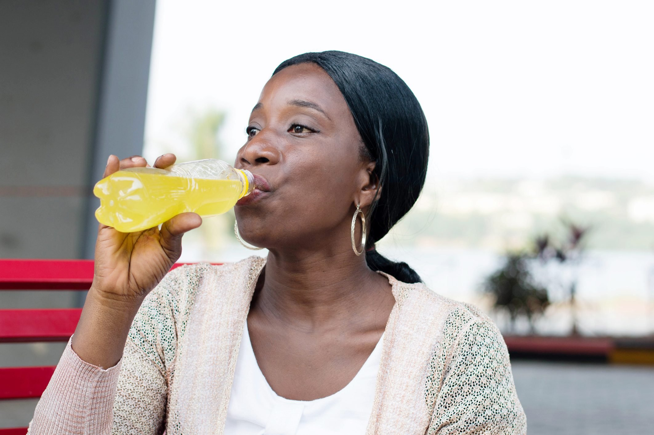 Woman drinking a soda at the bottle