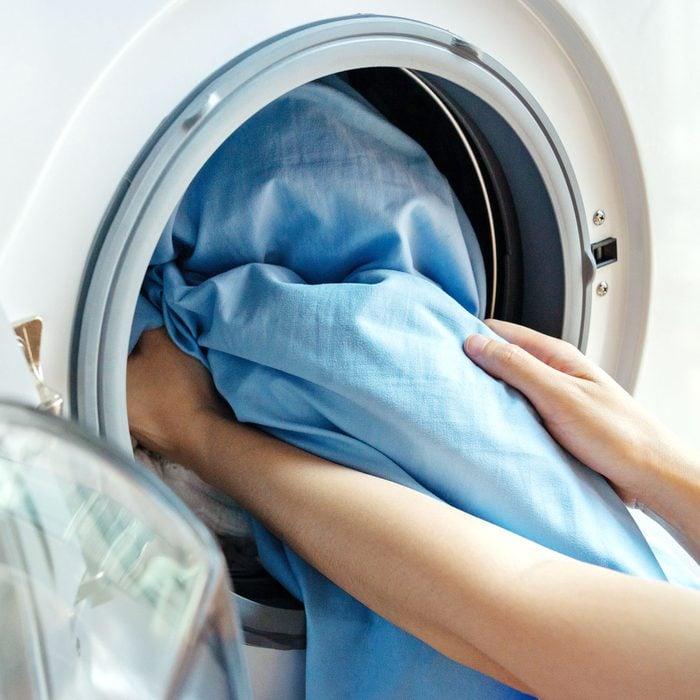 taking sheets out of washing machine