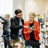Mature Couple Reading Nutrition Label On Food Item