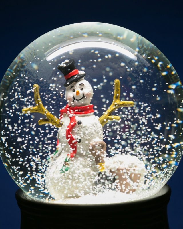 Close-Up Of Snow Globe Against Blue Background