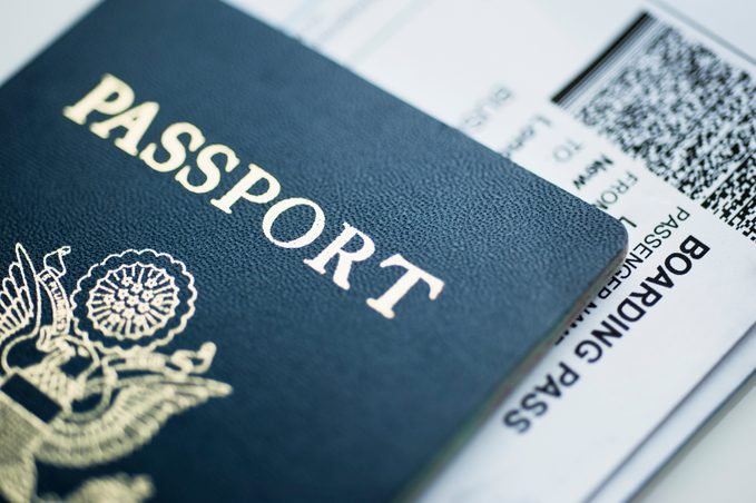 American passport with boarding pass inside