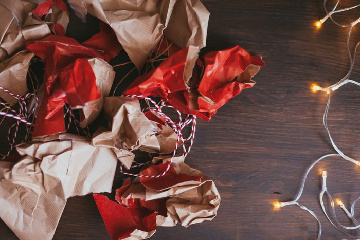 Directly Above Shot Of Crumpled Wrapping Papers By String Light On Table