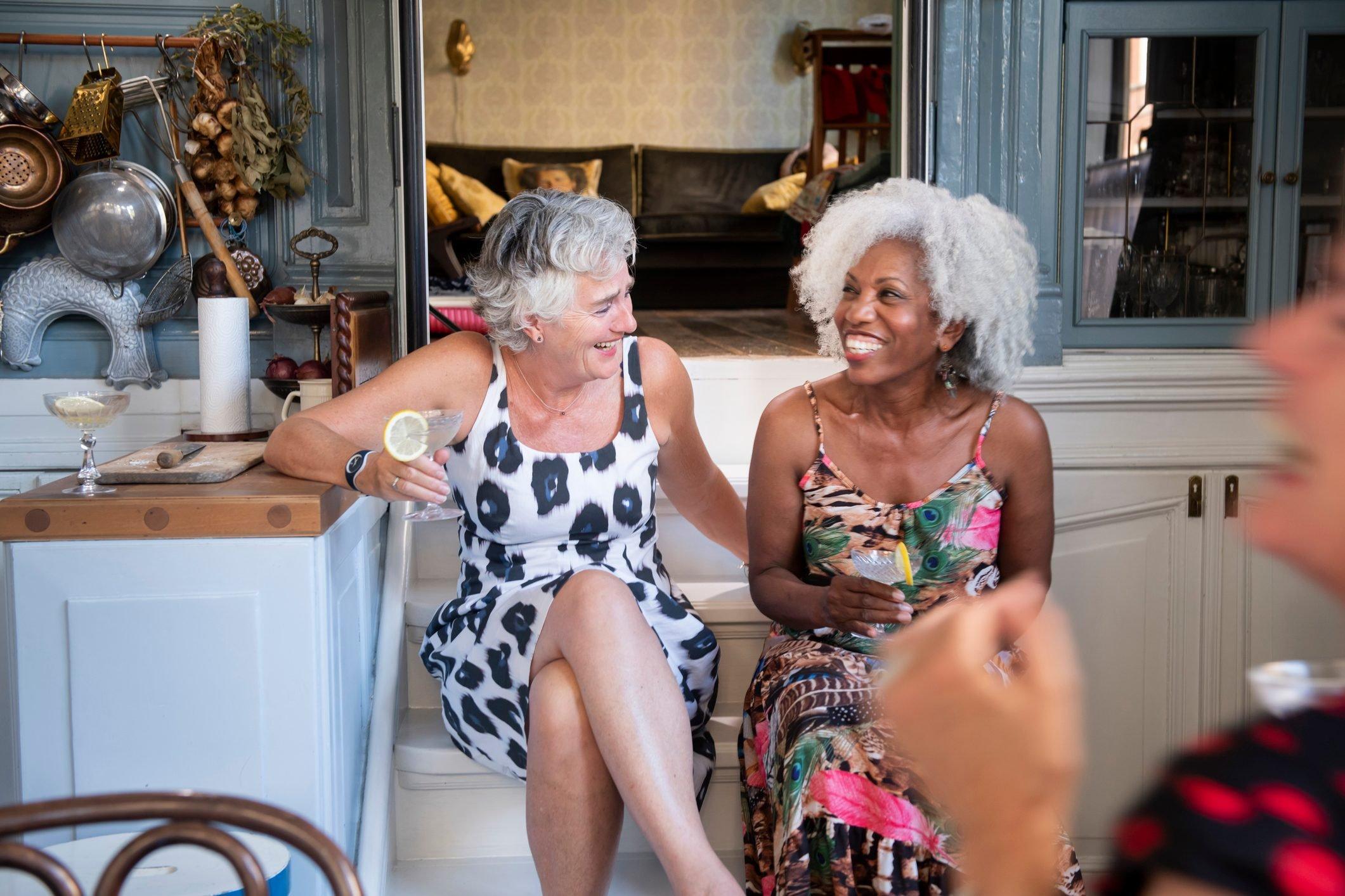 Senior women having fun at a small cocktail party