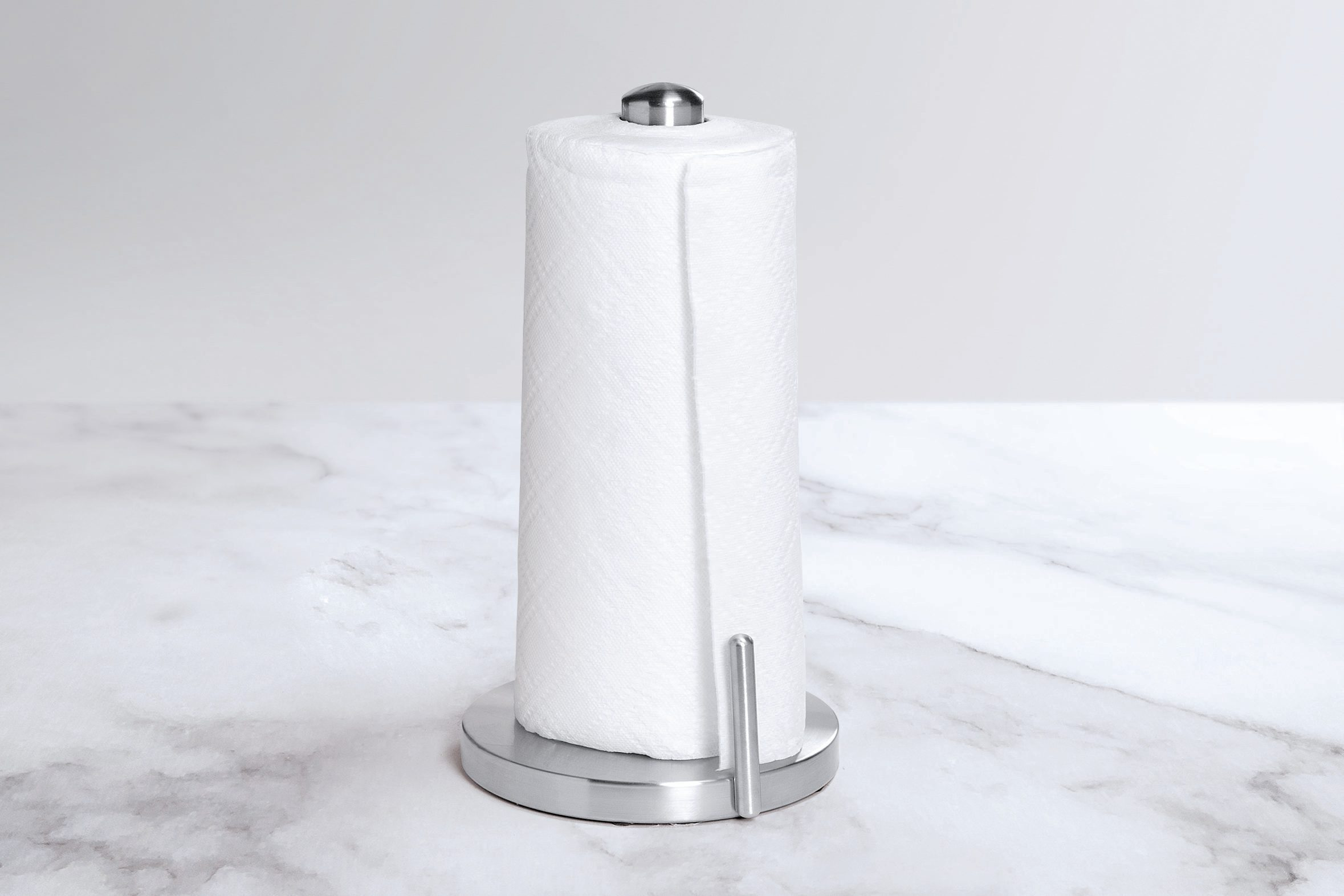 Paper towel holder on a white marble countertop