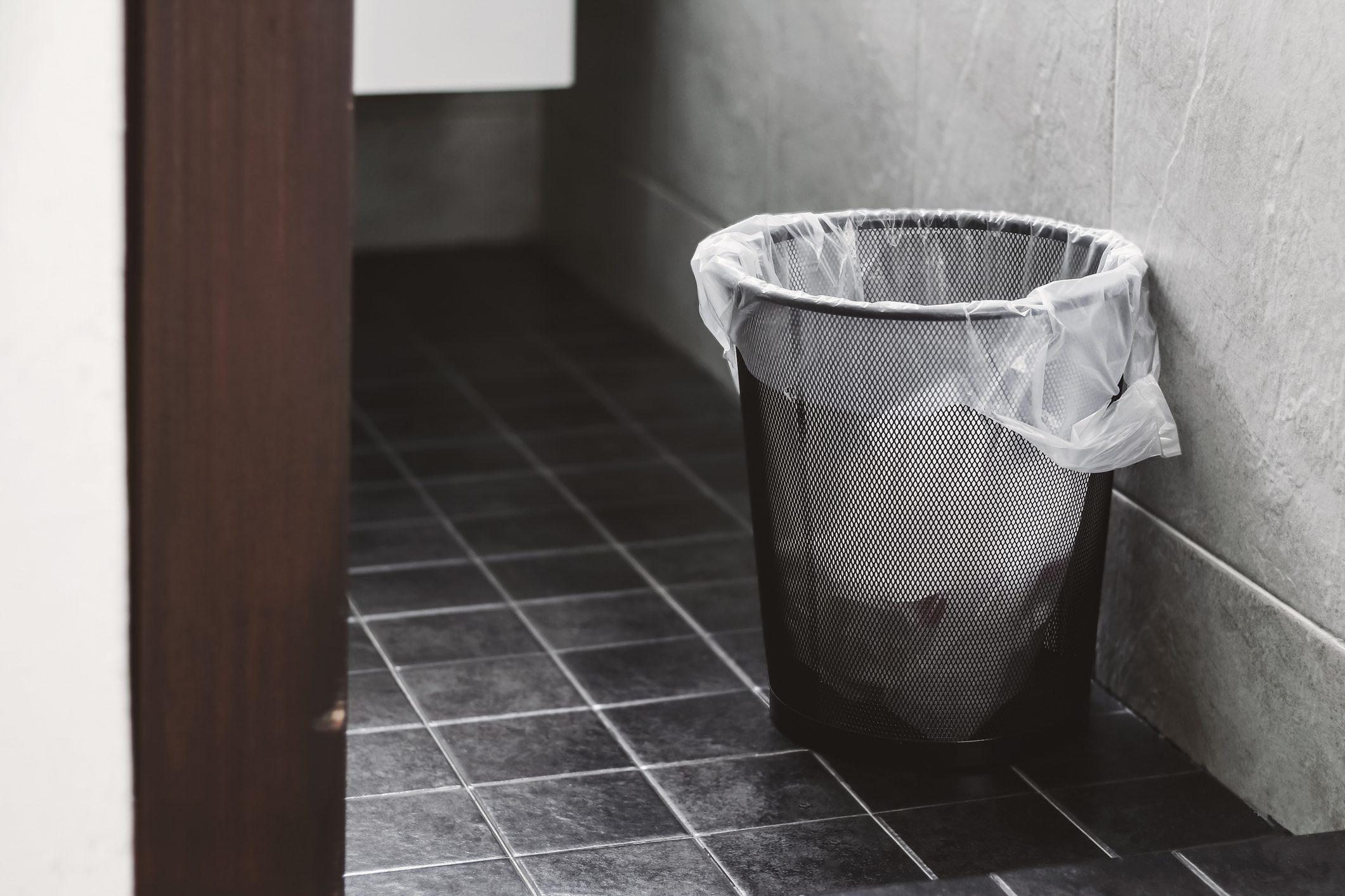 Dustbin On Tiled Floor