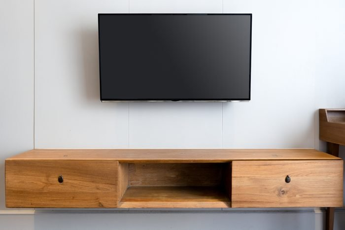 Blank Television Over Cabinet At Home
