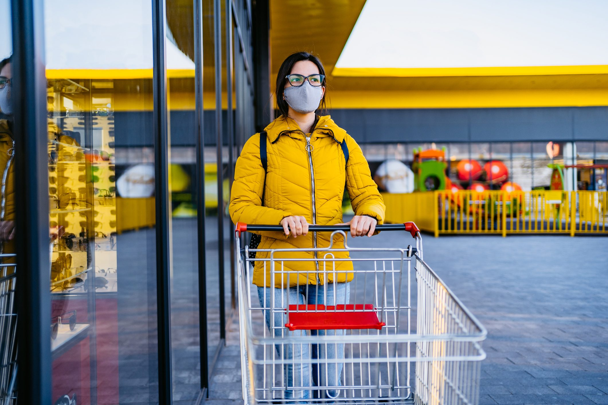 Woman in grocery store with face mask