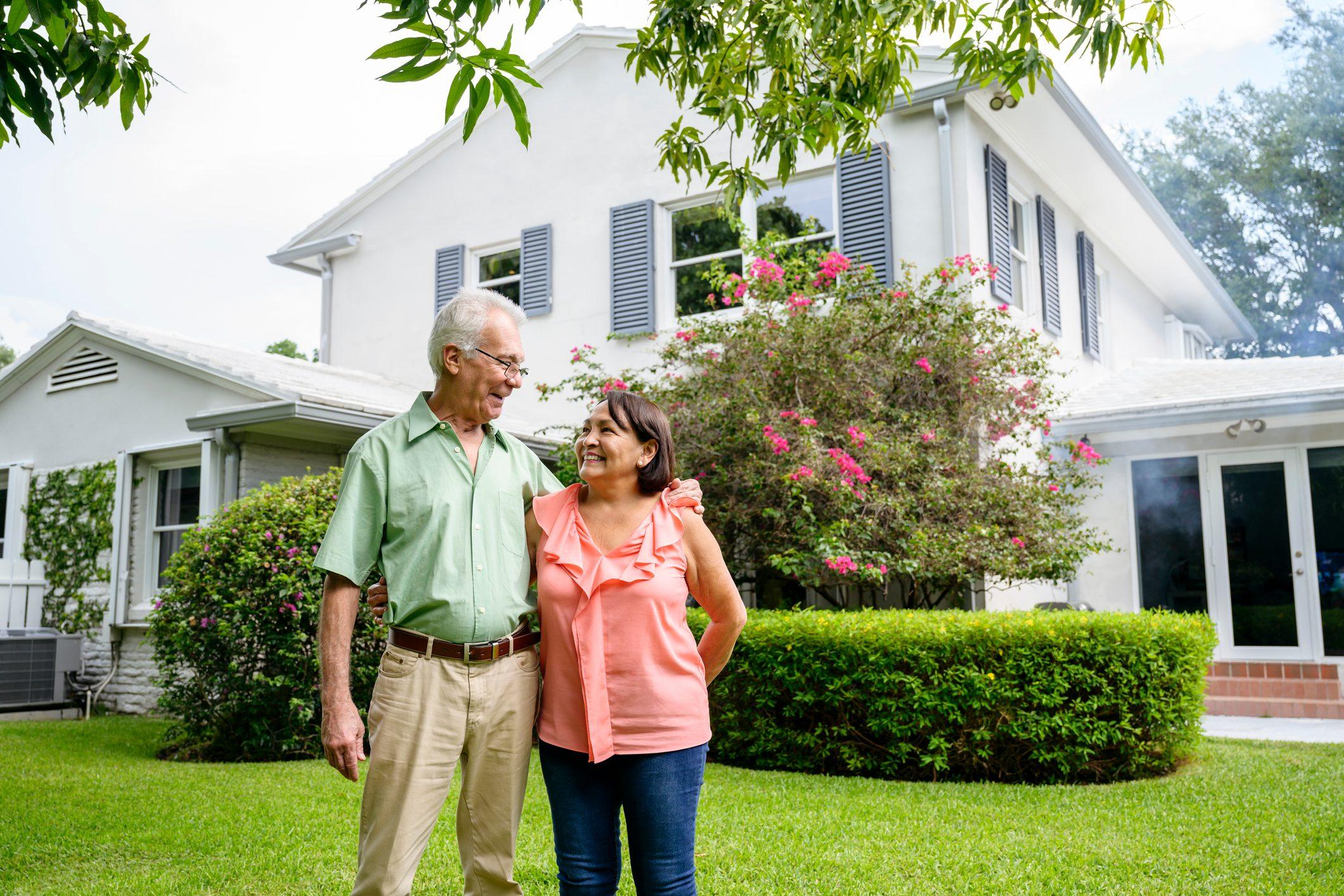 Embracing Latin American seniors in backyard of Miami home