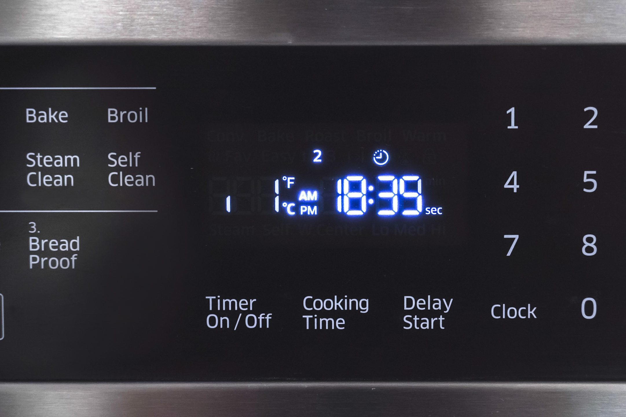 Close up of oven display flickering, control panel blinking. Stove electricity problem