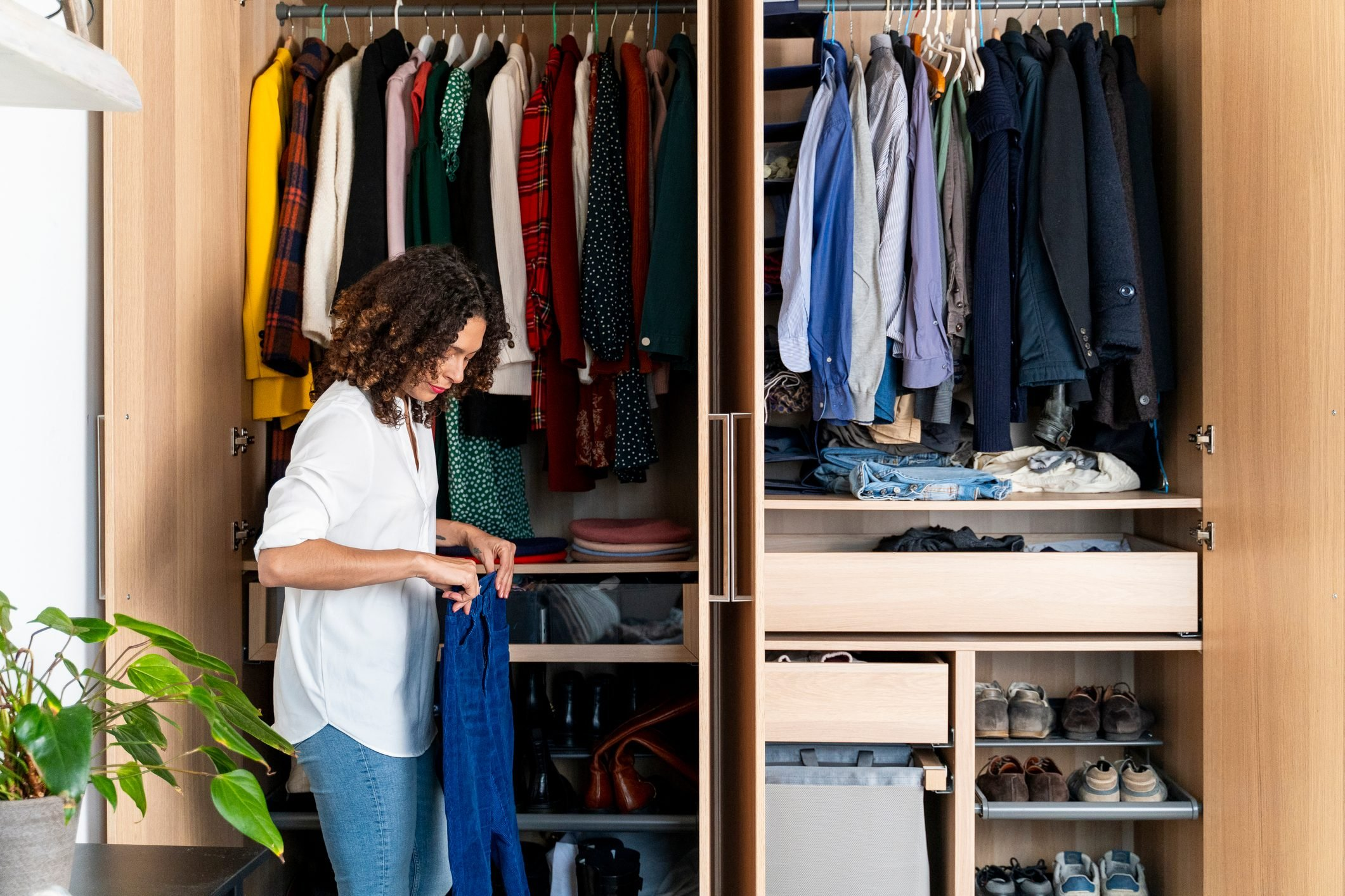 Woman clearing out her wardrobe
