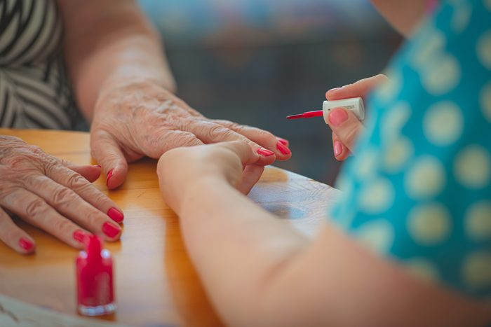 Freshly paintet red nails on an old woman