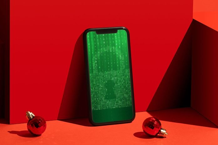 red scene with two ornaments with smartphone with green lock on the screen