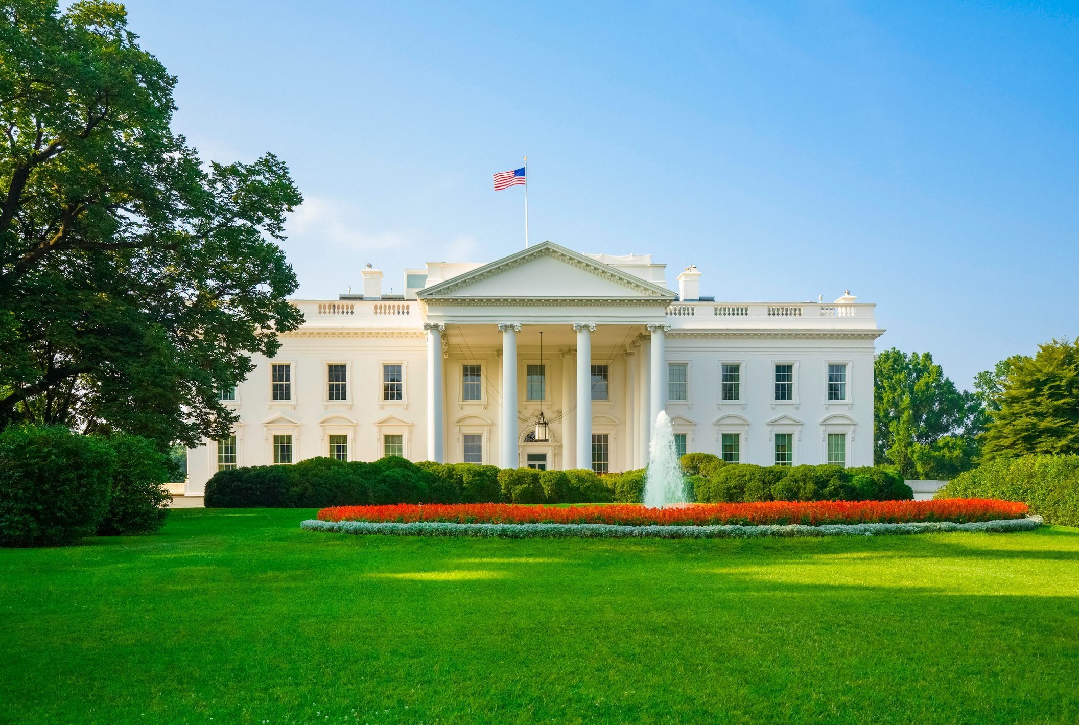The White House, green lawn, blue sky, early morning light