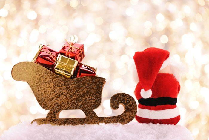 Santa sitting near his sleigh