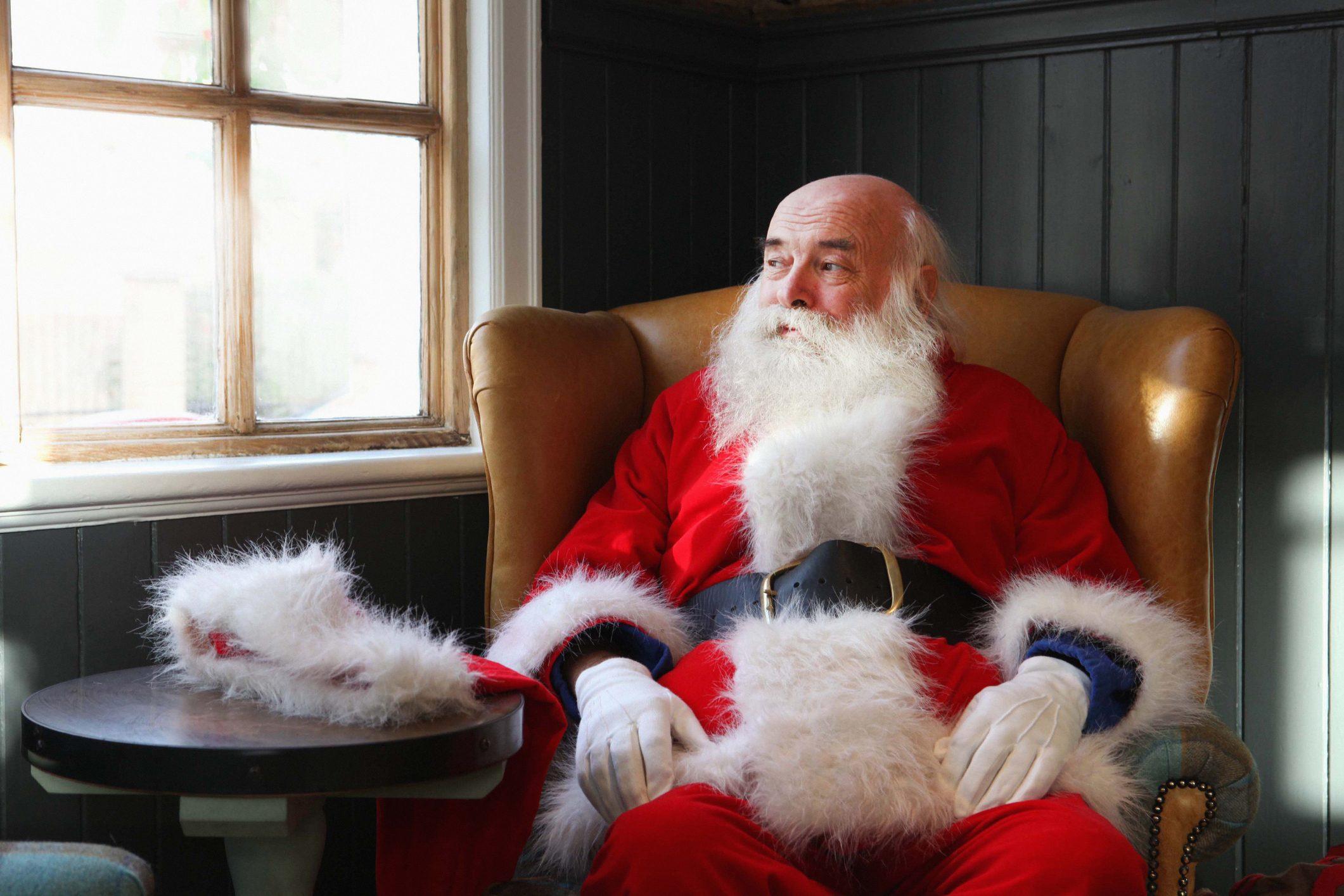 Santa Claus taking break in armchair