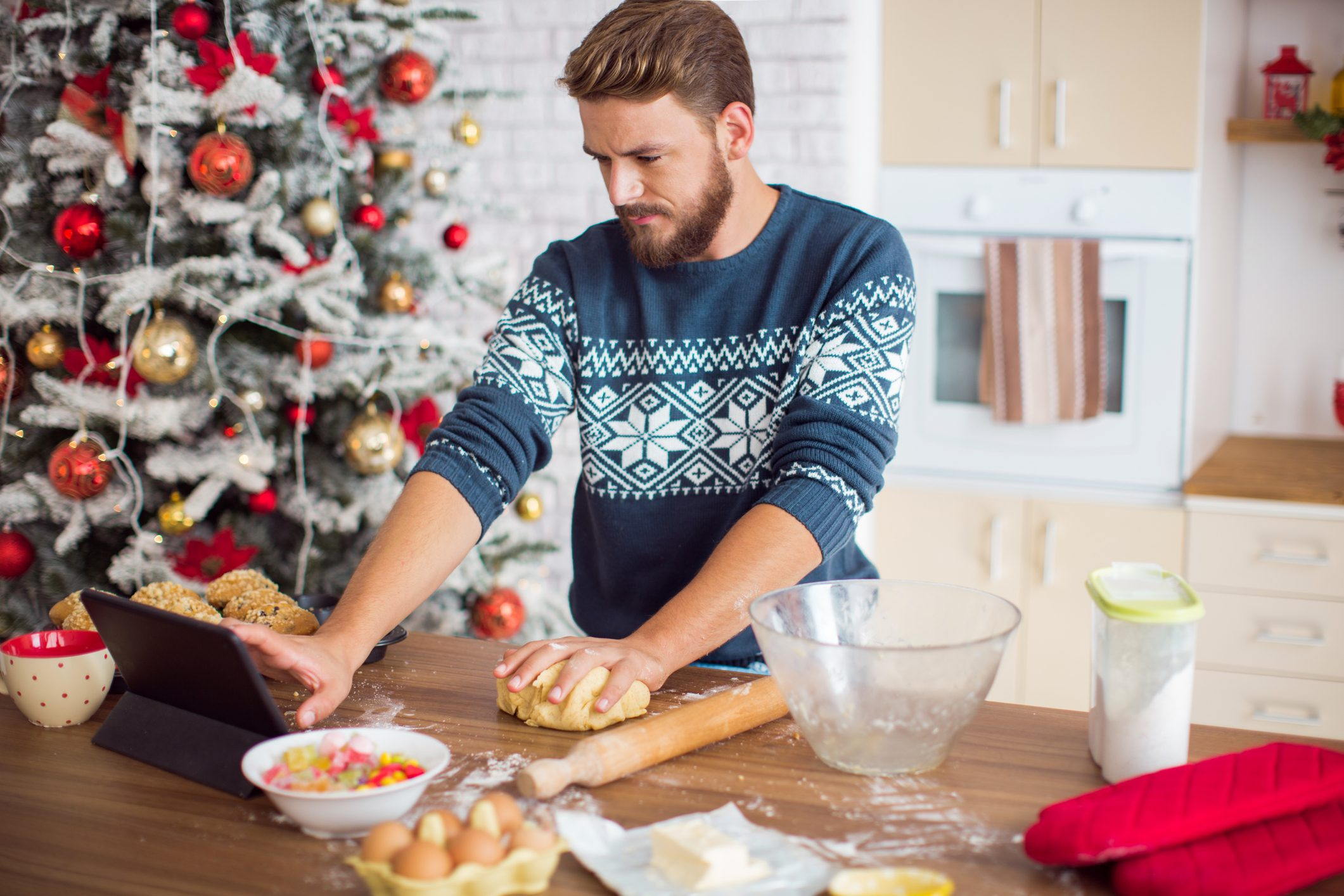 Man baking in kitchen for christmas.
